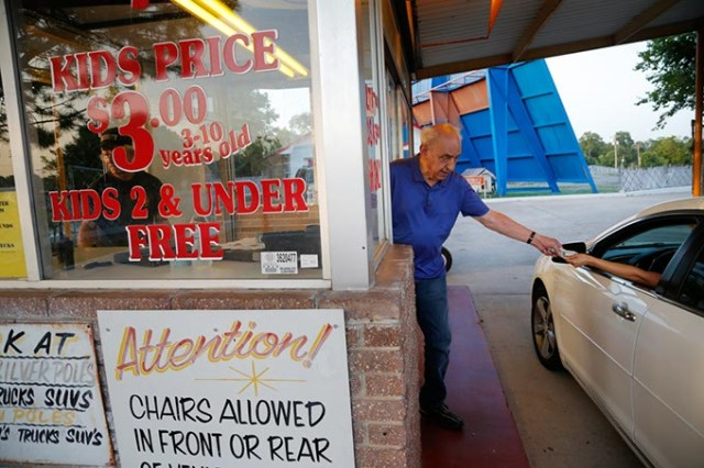 Owner Lindy Shanbour welcomes and sells tickets to first-run films at his Winchester Drive-In. (Garett Fisbeck)