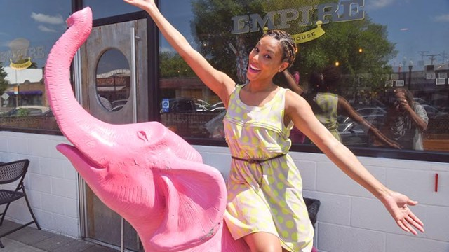 Paulette Nicole, aka Fat Nikki, on the pink elephant in front of Empire Slice House in the Plaza District, site of an up-comming food tour.  mh