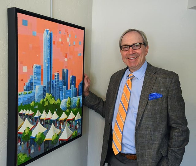 Peter Dolese, Arts Council of OKC Executive Director, with this years festival poster art, in their offices, 6-30-15.  mh