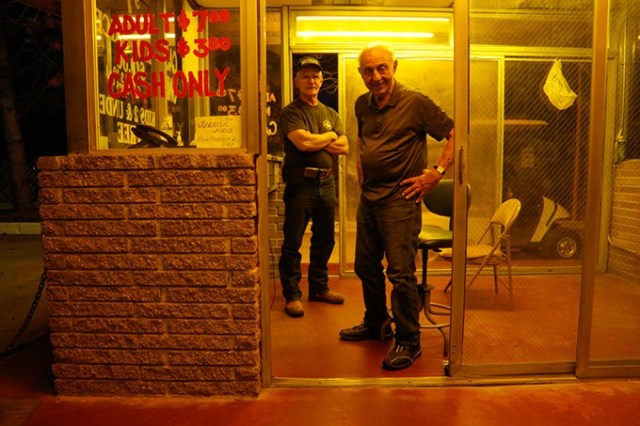 Lindy Shanbour, right, and Bob Deupree, left, run the ticket booth at the Winchester Drive-In.  (Garett Fisbeck)