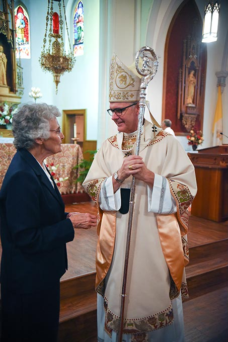Sister Marita Rother chats with Archbishop Paul Coakley after the anniversary Mass for Father Stanley Rother at Holy Trinity Catholic Churche in Okarche. (Mark Hancock)