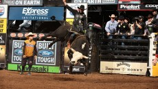 JB Mauney attempts to ride Wolf Creek/Shepherd Hills Cutlery/Tom Luthy's Shepherd Hills Stockman during the championship round of the Oklahoma City Built Ford Tough series PBR. Photo by Andy Watson