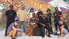 Left to Right, Jabee, John Devere Revive, Robert Levering, Miillie Mesh, Candace Liger, Nymasis, Gregory Jerome the Hip-Hip Festival organizer, Jeremiah Lavender, Angel Little, and Kris Kanaly.  All are artists participating in the Hip-Hop Festival, photographed in front of the mural in the parking area on Northest 9th Street in OKC, 8-26-2015.  Mark Hancock