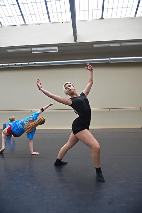 Freshman Izzy Dillingham dances with new overhead sky lighting in a modern dance class. (Mark Hancock)