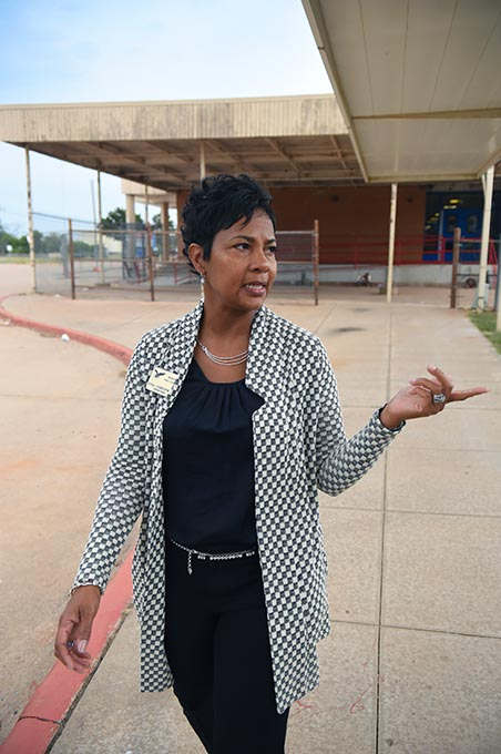 Cecilia Robinson-Woods walks through Millwood Public Schools in Oklahoma City.  (Mark Hancock)