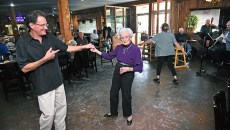George Camp and Ellen Wheeler dance during a performance at Ingrid's Kitchen by the band The Silvertops, 10-17-15.  (Mark Hancock)