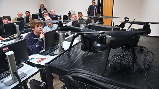 Students attending a free, two-hour new sUAS (Drone) operator orientation class, view videos and listen to instruction by Shane Snyder at OCCC's Professional Development Institute located off the main campus in the Plaza Major at the Crossroads Mall area, 11-9-15.  (Mark Hancock)