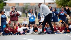 Kevin Durant greets students during a Kevin Durant Charity Foundation unveiling of a basketball court at North Highland Elementary School in Oklahoma City, Monday, Oct. 5, 2015.  (Garett Fisbeck)