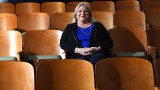 Recently divorced Tammy McKee might just attend a movie alone this Valentines Day, shown illustrating this idea at the Paraamount OKC theater, Film Row, Oklahoma City, 1-26-16.  (Mark Hancock)