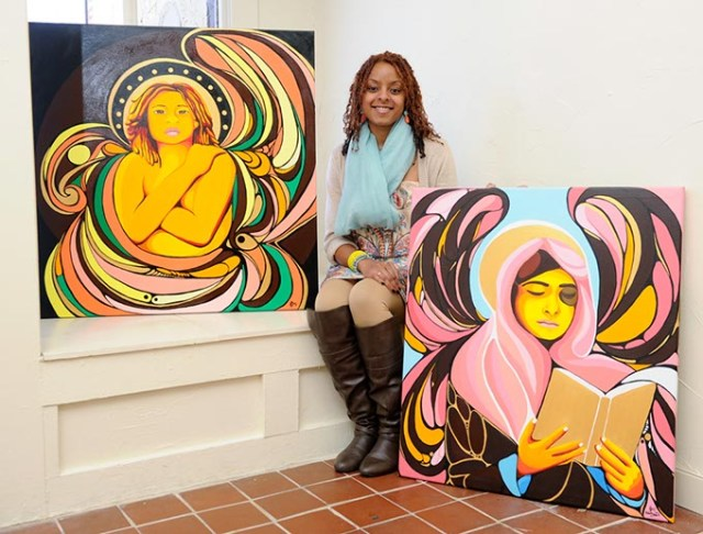 Ebony Iman Dallas with works from her exhibit Women in War Zones, on display through Feb. 27 at The Project Box. (Garett Fisbeck)