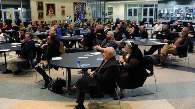 People listen during a Education Spending Accounts forum at Bishop McGuinness High School, Thursday, Jan. 21, 2016.  (Garett Fisbeck)