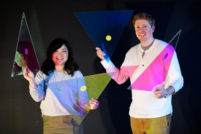 Anh Weber and Adam Edge pose for a photo with dichroic film on acrylic, used to create a faceted fabric, at HSE, Wednesday, March 9, 2016.  (Garett Fisbeck)
