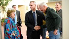 Congressman Steve Russell shakes hands with Don Spurgin before a town hall meeting at The Village Municipal Building, Tuesday, March 8, 2016.  (Garett Fisbeck)