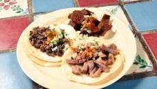 Azada, Milaneza, and Lengua tacos at Carnitas Michoacan in Edmond, Thursday, May 26, 2016.  (Garett Fisbeck)