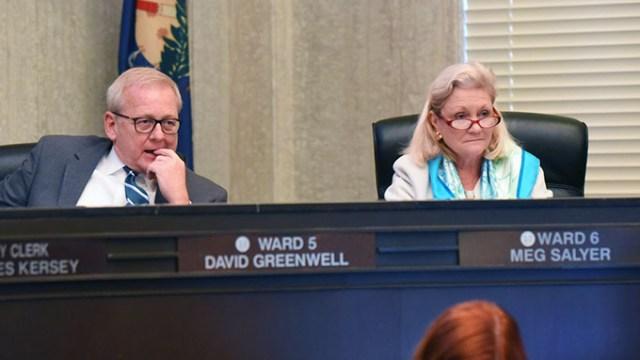 Ward 5 Councilman David Greenwell, and Ward 6 Councilwoman Meg Salyer, listen to Curbside Chronicle editor, Rayna O'Connor, speak during the 12-2-15 Oklahoma City Council meeting.  (Mark Hancock)