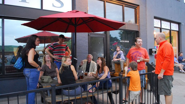 A happy bunch chats away on the patio in front of Saints, during Live on the Plaza, 9-13-13.  mh