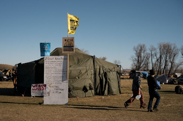 A centralized Standing Rock Sioux Tribe help tent and volunteer training sign at a camp near Dakota Access Pipeline development. (Wade Dunstan / for Oklahoma Gazette)