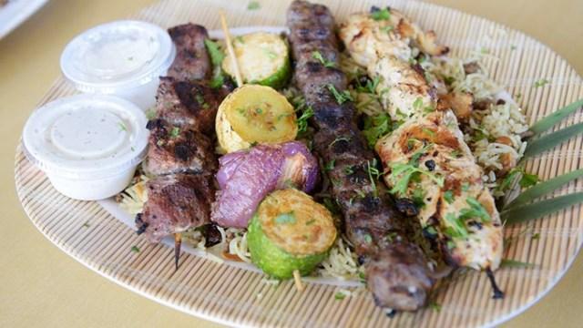 Mixed grill kabob platter over hashwa at Jerusalem Mediterranean Cuisine in Edmond, Thursday, Nov. 17, 2016.  (Garett Fisbeck)