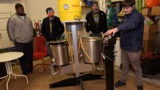 Evan Smith shows a test batch brewing kit at Vanessa House Beer Company as Nick White, Andrew Carrales, and Justin Wright look on, Monday, Nov. 21, 2016.  (Garett Fisbeck)