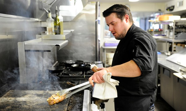 Chef Paul Langer works in the kitchen at Guernsey Park in Oklahoma City, Monday, Jan. 4, 2016.  (Garett Fisbeck)