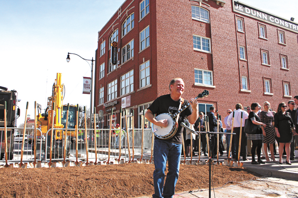Johnny Baier strums the banjo as the crowd gathers for the groundbreaking of the MAPS 3 modern streetcar in Bricktown. (Laura Eastes)