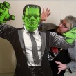 Art Sunday poses for a photo with Frankenstein's monster to promote the Underground Monster Carnival, Tuesday, Feb. 7, 2017.  (Garett Fisbeck)