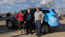 Lori Rasmussen, Nick Farlow, and Sidney Terry pose for a photo with the Embark Rideshare car in Edmond, Monday, Feb. 20, 2017.  (Garett Fisbeck)