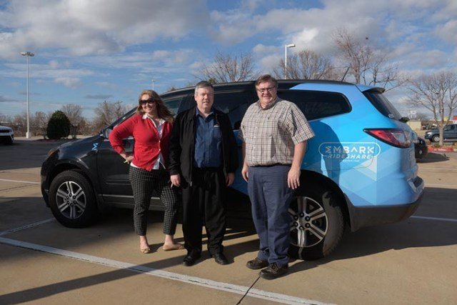 <em>from left</em> Lori Rasmussen, Nick Farlow and Sidney Terry with an Embark Rideshare car in Edmond. All three commute from Edmond to Boeing's south OKC facility. (Garett Fisbeck)