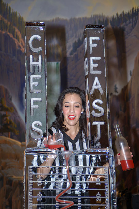 A volunteer pours a drink through an ice luge at Chefs' Feast in 2016. (Regional Food Bank of Oklahoma / provided)