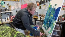 Tammy Conover works on a painting at her studio, Monday, Feb. 27, 2017.  (Garett Fisbeck)