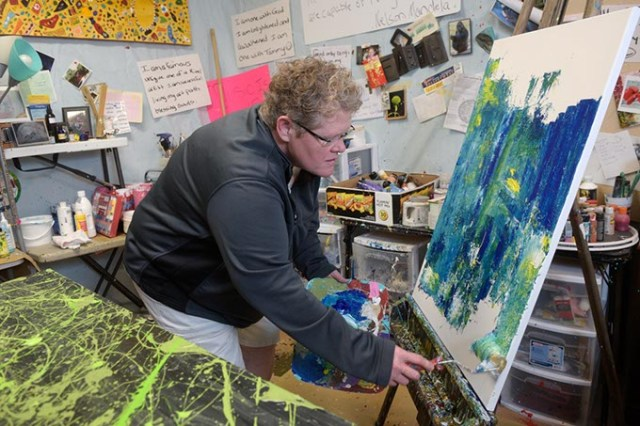 Tammy Conover demonstrates her painting technique inside her south Oklahoma City studio. (Garett Fisbeck)
