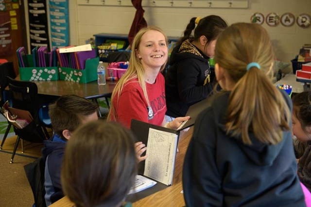 AmeriCorps member Abby Shelley works with Putnam City students during an afterschool program. (Garett Fisbeck)