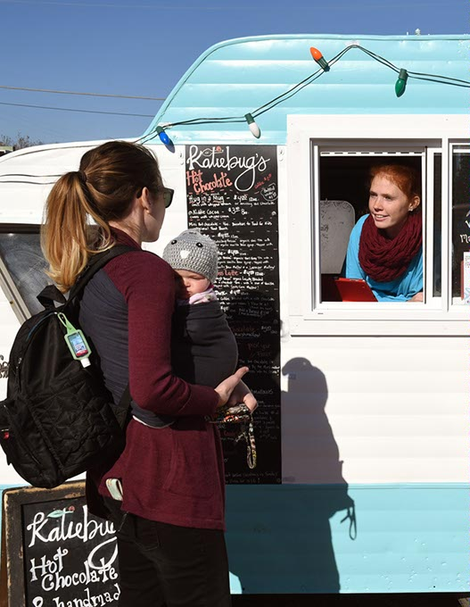 Customers Molly <em>left</em> and Samantha Cooper order some hot chocolate at Katiebug's Shaved Ice and Hot Chocolate. (Gazette / file)