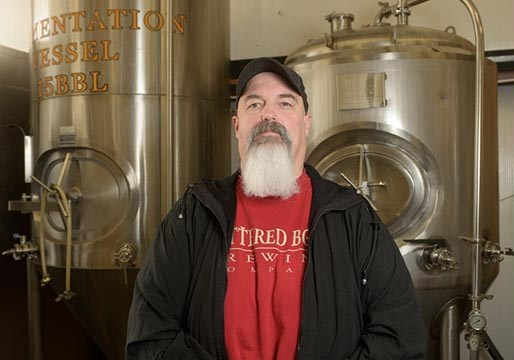 Mike Sandefur poses for a photo at Battered Boar Brewing Company, Monday, June 5, 2017.  (Garett Fisbeck)