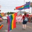 Pride flags are held from the crowd during the 30th Anniversary OKC Pride Parade on Sunday, June 25, 2017. (Cara Johnson).
