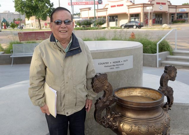 Vinh Nguyen stands near the place the Brothers in Arms monument will be installed Thursday. (Garett Fisbeck)