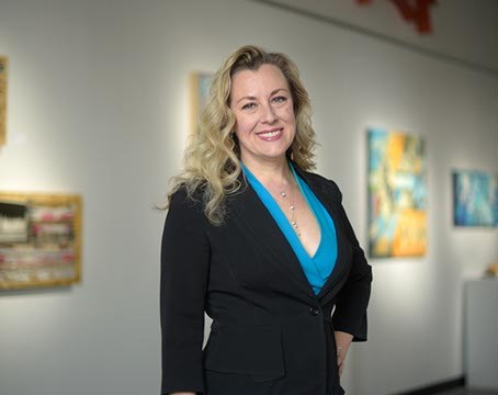 Kendra Horn, executive director of Women Lead, poses for a photo at Kasum Contemporary Fine Art, Wednesday, March 8, 2017.  (Garett Fisbeck)