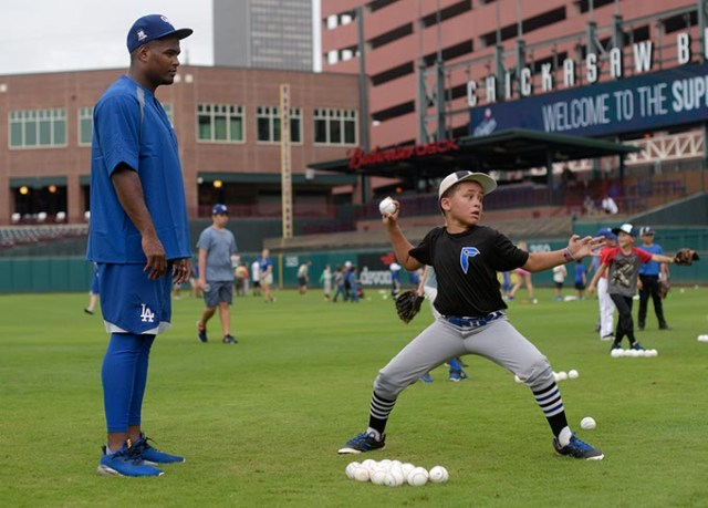 Fabio Castillo works with William Frazier during a recent OKC Dodgers Clinic in conjunction with Supermercados Morelos. (Garett Fisbeck)
