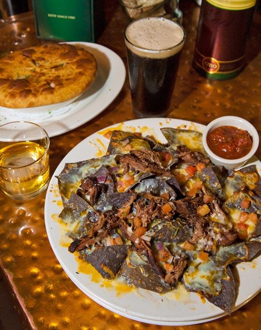 Pot roast nachos with a chicken pot pie, Irish whiskey and beer at Blackbird Gastropub. (Gazette / file)