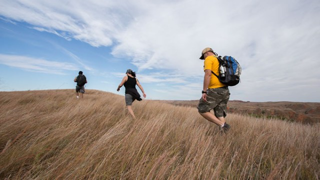 Hikers trek the grasses of Four Canyon Preserve in western Oklahoma as part of a field trip with the Oklahoma chapter of The Nature Conservancy. | Photo Ryan West / The Nature Conservancy / provided