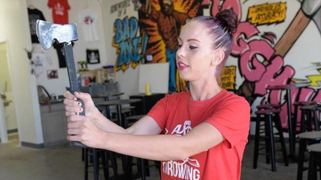 Katie Morlock, axe master at Bad Axe Throwing, demonstrates proper throwing technique. (Photo Garett Fisbeck)