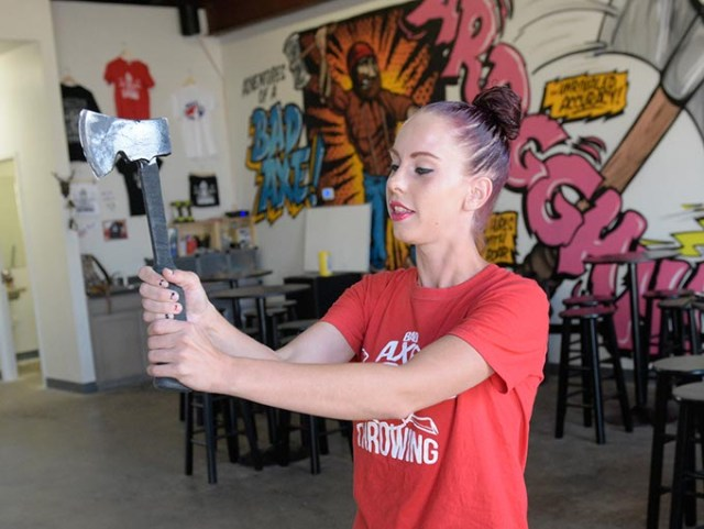 Katie Morlock, axe master at Bad Axe Throwing, demonstrates proper throwing technique. (Garett Fisbeck)