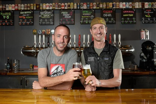 Daniel Mercer, co-founder, and Blake Jarolim, head brewer, plan for continued expansion of their COOP line. (Garett Fisbeck)