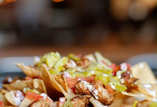 Chicken nachos at Oak & Ore in Oklahoma City, Tuesday, Sept. 22, 2015.  (Garett Fisbeck)