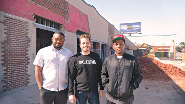 From left: Sandino Thompson, Jonathan Dodson and Jabee Williams stand at the entrance of what will become the Oklahoma City Clinic. (Photo Megan Nance)