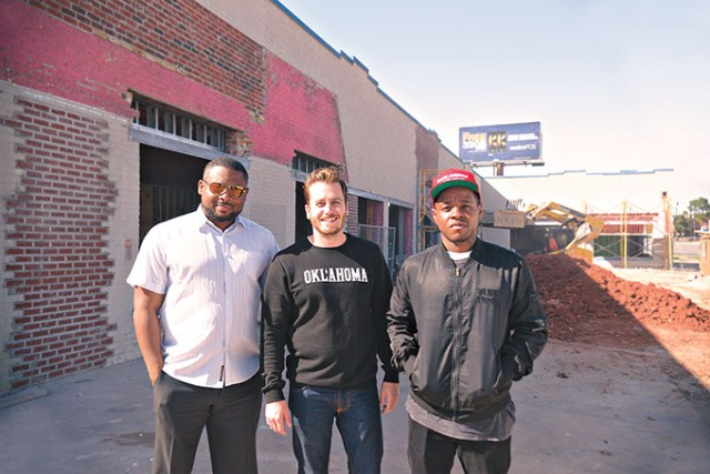 <em>from left</em> Sandino Thompson, Jonathan Dodson and Jabee Williams stand at the entrance of what will become the Oklahoma City Clinic. (Megan Nance)