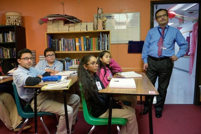Superintendent Umit Alpasian observes a seventh-grade English class at Dove Science Academy, which was one of six Oklahoma schools named a National Blue Ribbon School in 2017. (Garett Fisbeck)