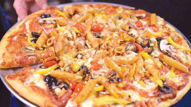 The Bossy Big Sister pizza makes cooked pasta a topping. ( Jacob Threadgill)