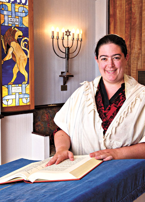 Rabbi Abby Jacobson from Emanuel Synagogue engages in nontraditional food for Hanukkah. (Gazette / file)
