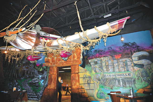 A giant plane hangs suspended in The Ruins Bar & Grille. (Jacob Threadgill)